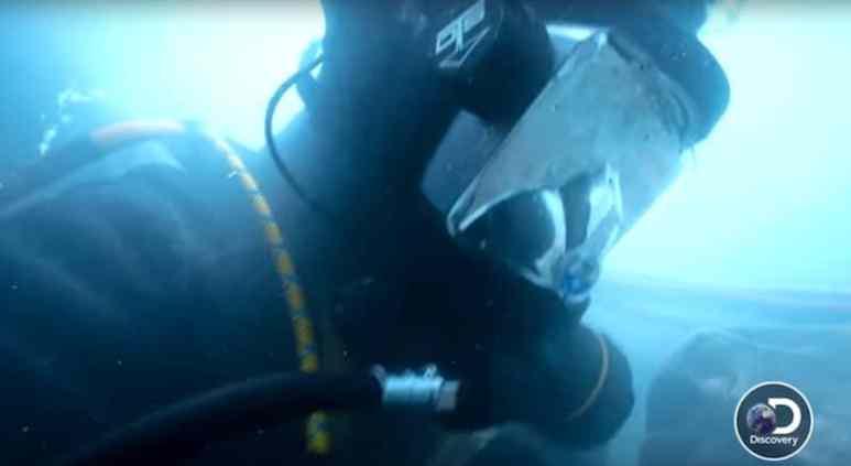 Carlos underwater in scuba gear on Gold Rush: White Water