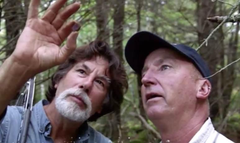Rick Lagina and Gary Drayton examining gemstone
