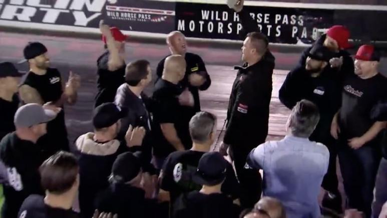 Ryan Martin holding cash with the rest of the Street Outlaws team