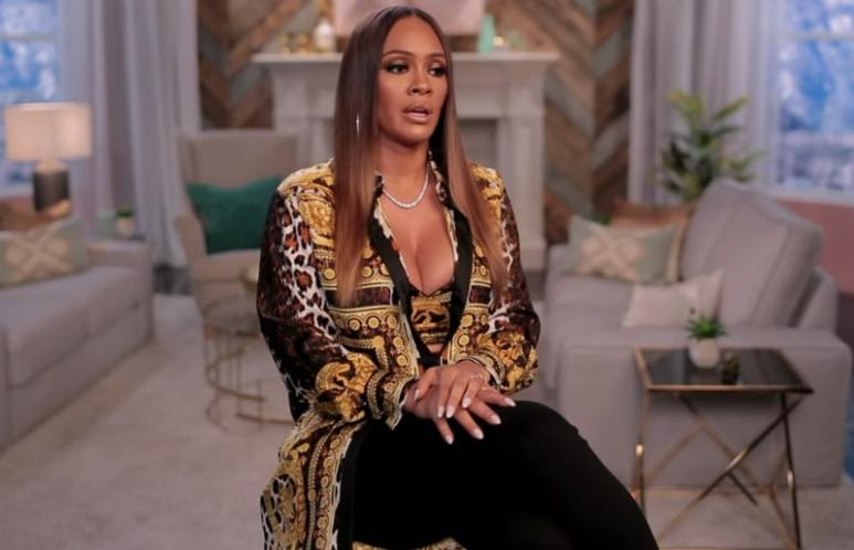 Evelyn Lozada sits in the confessional on Basketball Wives