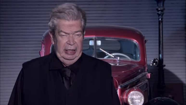 The Old Man from Pawn Stars in the confessional