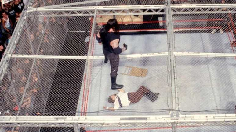 The Undertaker stands over Mick Foley in this classic Hell in a Cell match from 1998