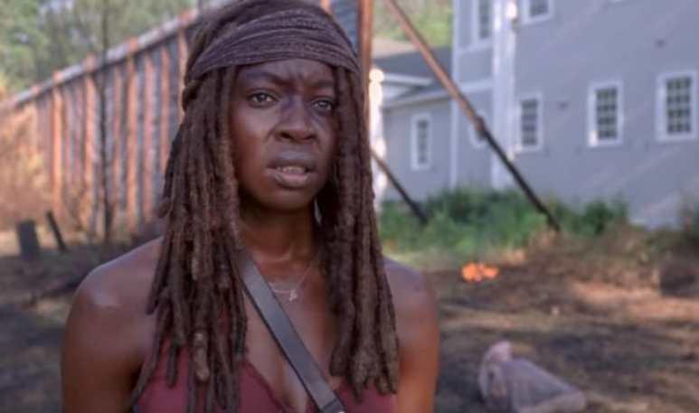 Michonne standing outside in Woodbury on The Walking Dead