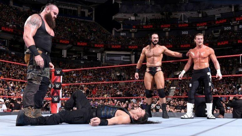 Braun stares ta a fallen Roman Reigns
