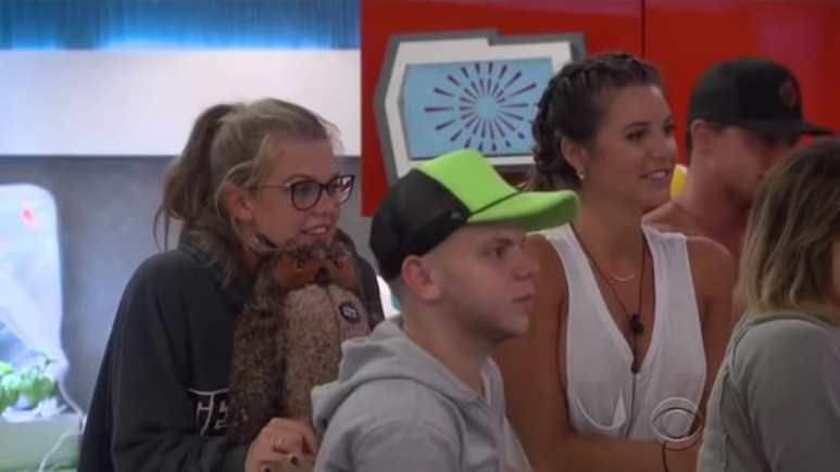 Haleigh, JC, Angela and part of Sam's face as they watch Zingbot on Big Brother 20