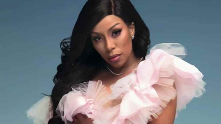 K. Michelle in a frilly pink dress for the Love & Hip Hop: Hollywood intro