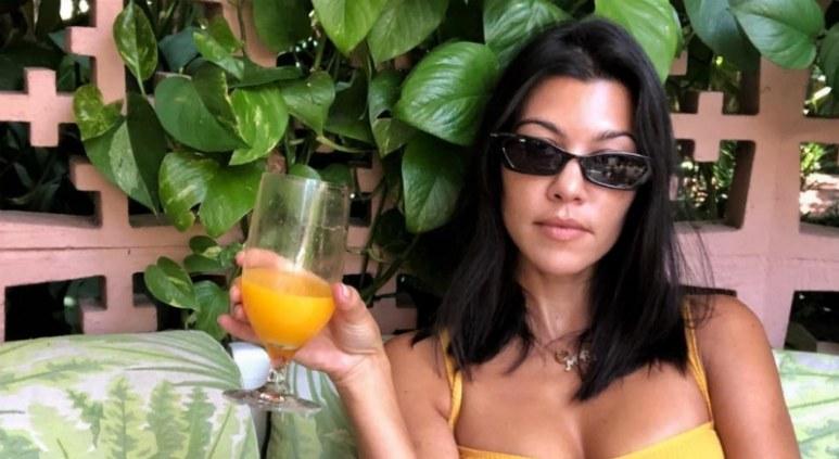 Kourtney Kardashian drinking orange juice