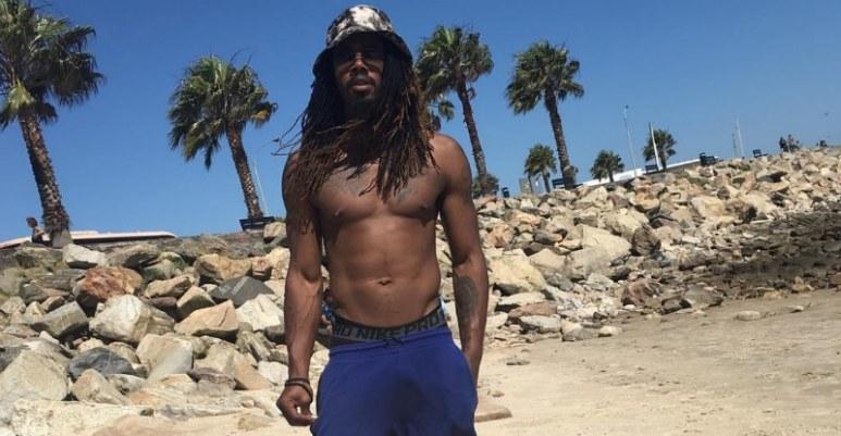 Kwame Brown shirtless on the beach