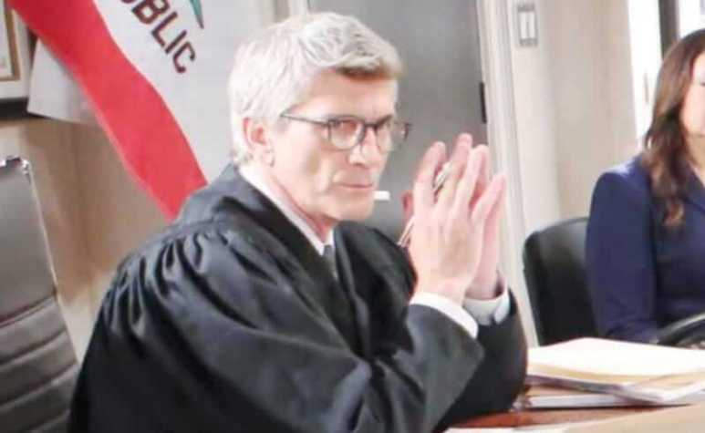 Joe Lando seated at his desk as Judge McMullen on Days of Our Lives
