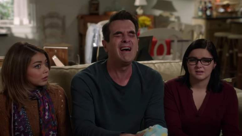 Haley Dunphy next to tv dad Phil Dunphy and sister Alex Dunphy of Modern Family