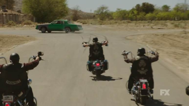 Still image from Mayans M.C. Escorpión/Dzec preview. The Santo Padre charter chases a driver looking for information