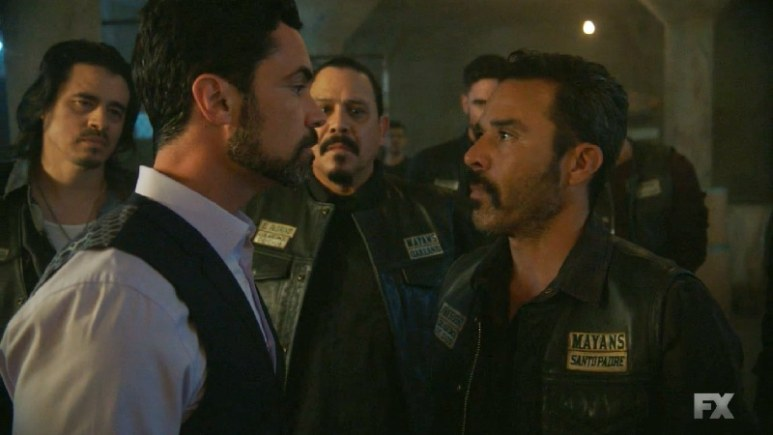 Still image from Mayans M.C. Escorpión/Dzec. President Bishop (Michael Irby) stands up to Miguel Galindo's brutality (Danny Pino). Pic credit: FX