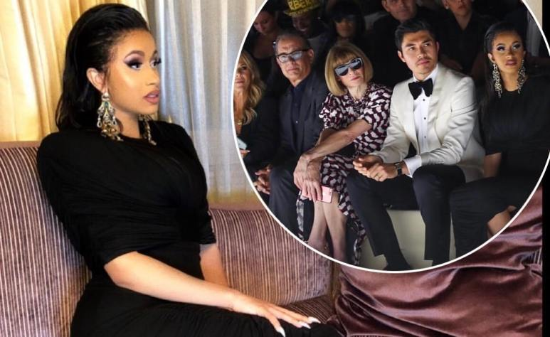 Cardi B in the photos she posted of herself sitting alongside Anna Wintour and Tom Hanks at New York Fashion Week