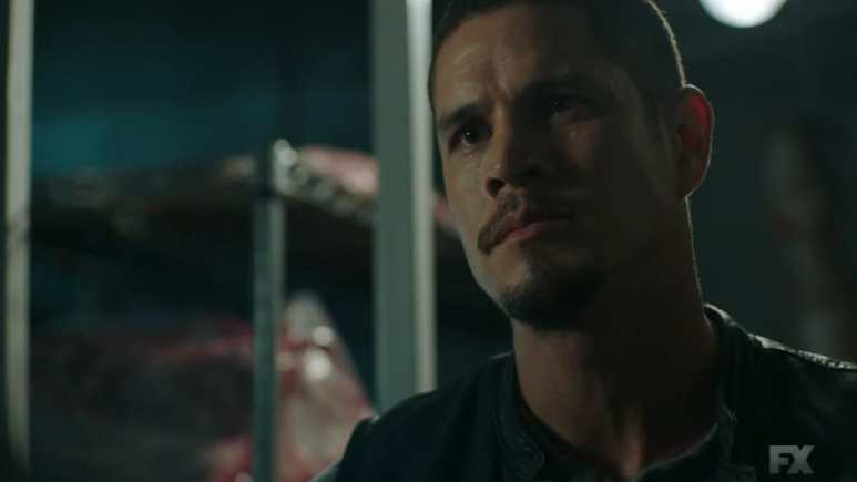 Still image from Perro/Oc. EZ has an unexpected meeting with Kevin in his father's butcher shop.