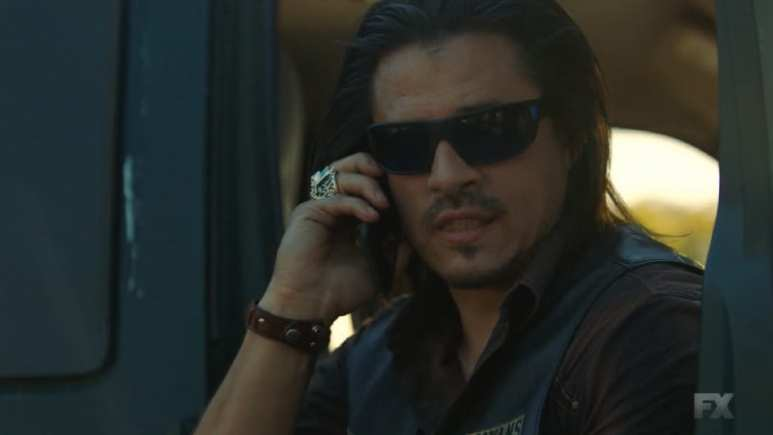 Still image from Perro/Oc. Secretary Riz calls Sons of Anarchy SAMDINO charter in for back up.