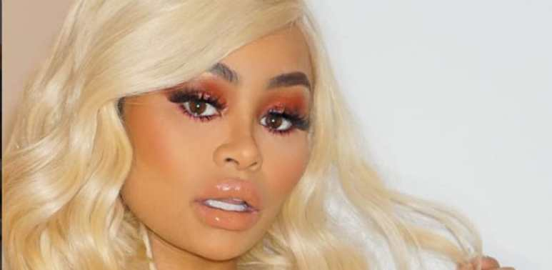 Blac Chyna poses with blonde hair and a vacant stare