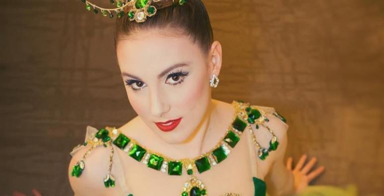 Tiler Peck dressed in emerald green for a performance with the NYC ballet