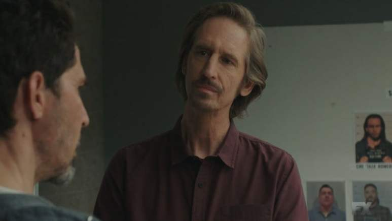 Still Image from Mayans M.C. Cucaracha/K'uruch. Kevin Jimenez informs Lincoln Potter of Miguel's detainment and Potter releases EZ. Pic Credit: FX.