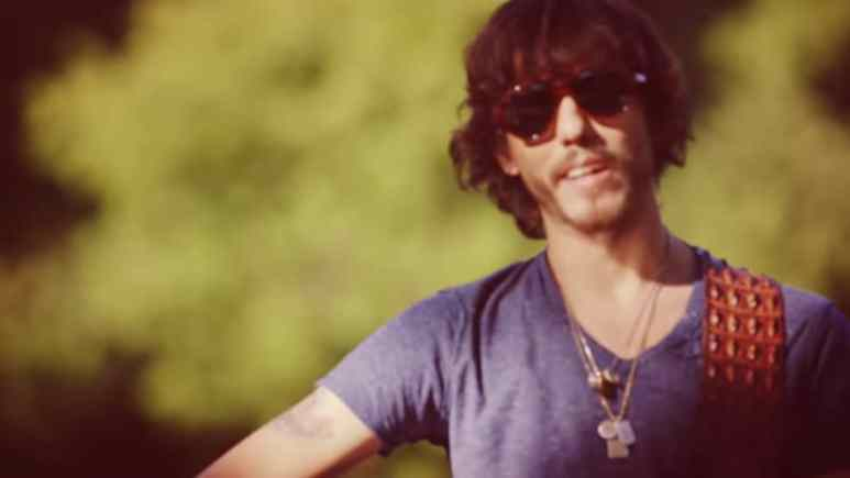 Chris Janson in the music video for Buy Me A Boat. Pic credit: Chris Janson/YouTube