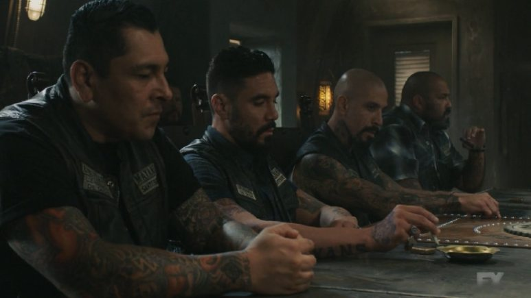 Still Image from Mayans M.C. Cuervo/Tz'ikb'uul. The Mayans vote on supplying the Galindo cartel with weapons under the radar with help from their allies, the Sons of Anarchy. Pic Credit: FX