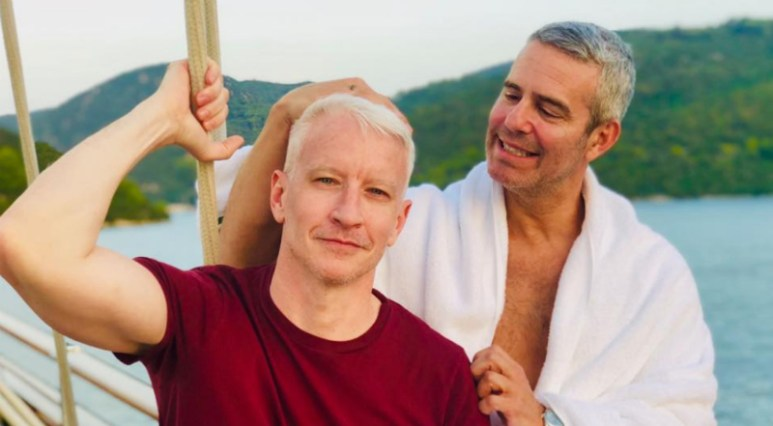 Anderson Cooper and Andy Cohen posing together on a boat