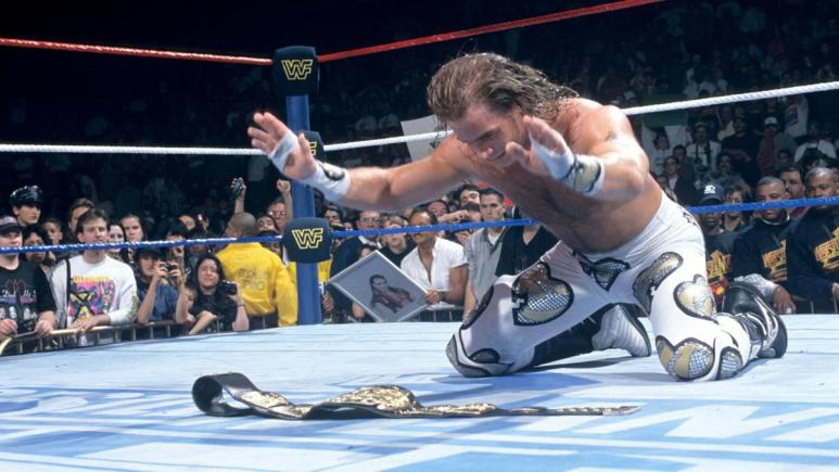 Shawn Michaels worships his title belt in the middle of the WWE ring
