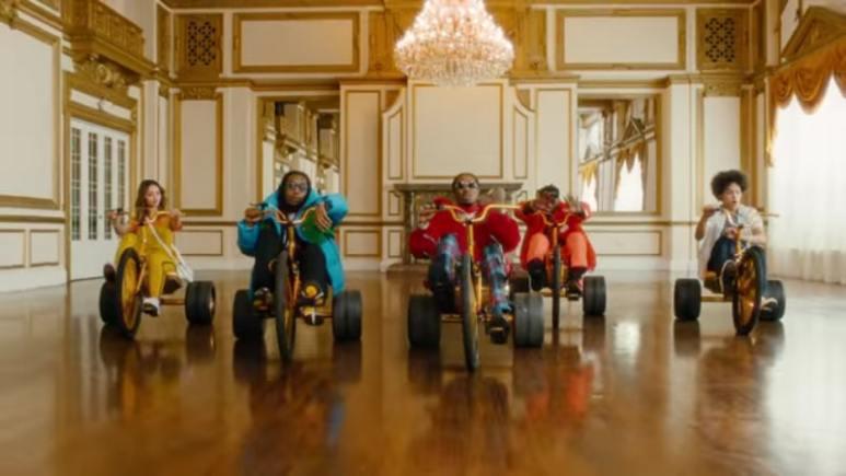 Migos ride through the Mountain Dew commercial on trikes