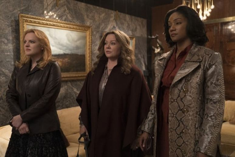 Elisabeth Moss as Claire, Melissa McCarthy as Kathy and Tiffany Haddish as Ruby in The Kitchen.