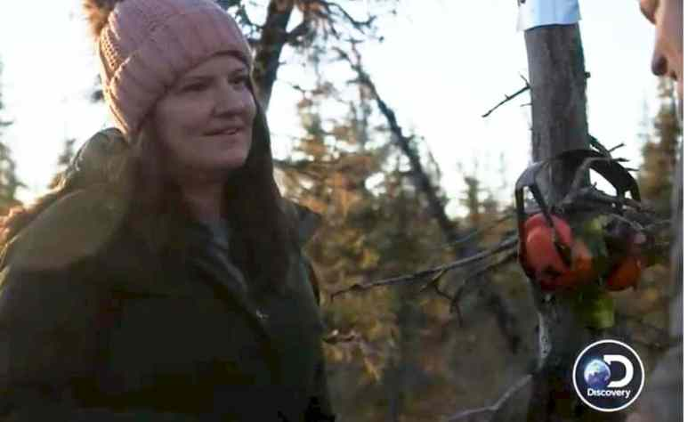 Jane Kilcher cuts down a tree on Alaska: The Last Frontier