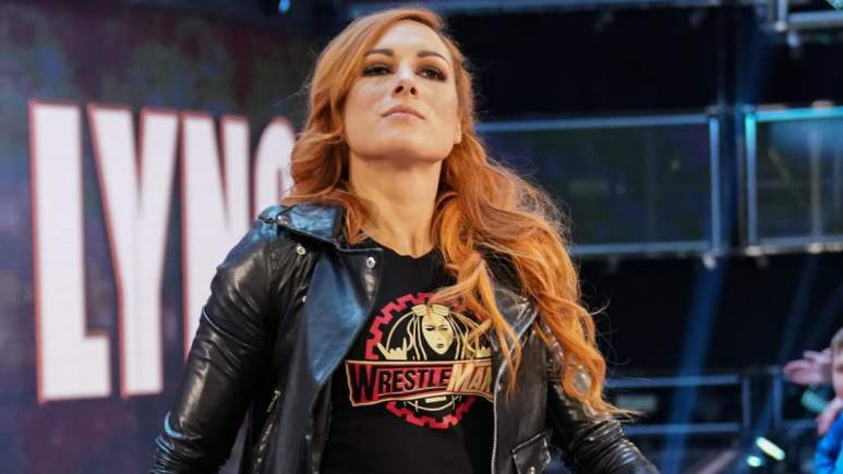 Becky Lynch enters the WWE ring wearing a WrestleMania tshirt