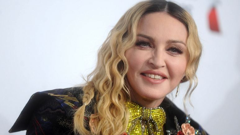 Madonna smiles