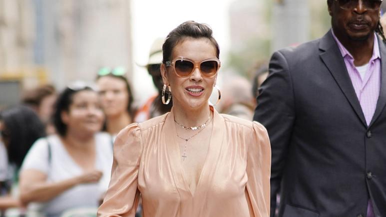 Alyssa Milano smiles in photo