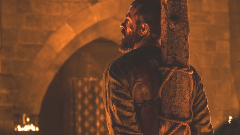 Landry is tied to the stake in Episode 8 of Knightfall Season 2