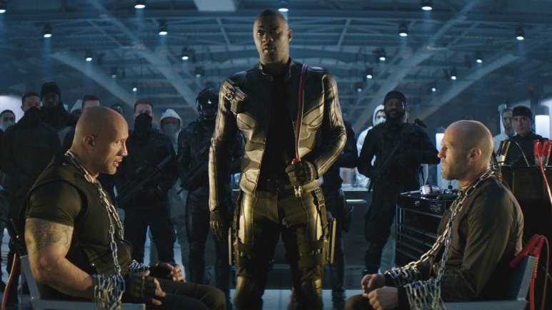 Dwayne Johnson and Jason Statham being tortured by Idris Elba in Hobbs and Shaw