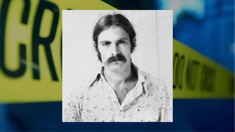 Bernard Eugene Giles in a black and white police mugshot