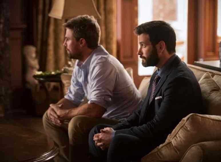 Stephen Amell as Oliver Queen/Green Arrow and Colin Donnell as Tommy Merlyn on Arrow