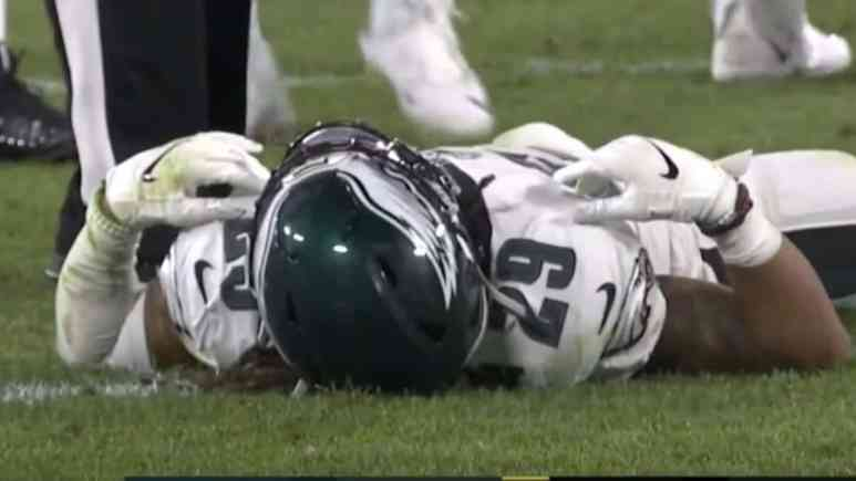 eagles player avonte maddox lays on field after suffering hard hit from his eagles teammate in game against packers