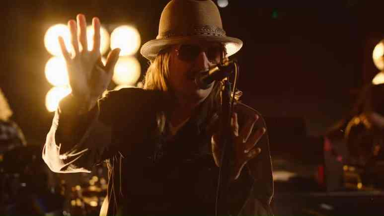 Kid Rock performs at a concert