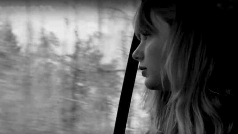 Taylor Swift reminiscing out a car window