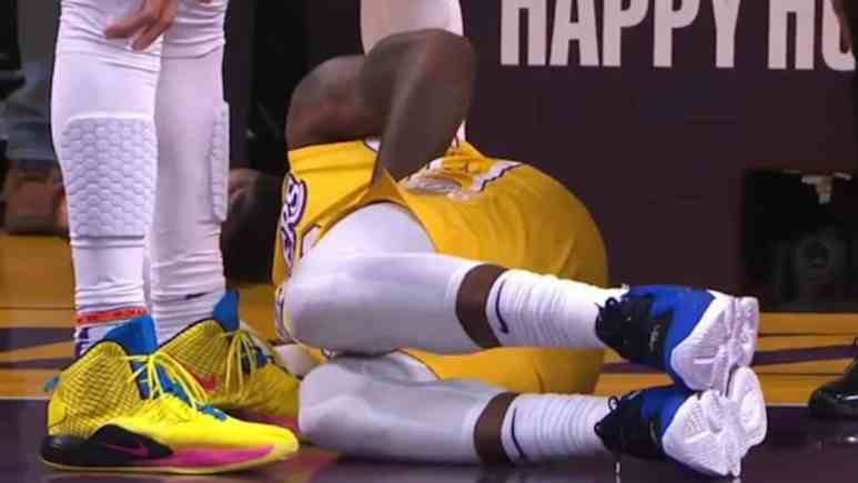 lebron james remains down on the court during christmas day game