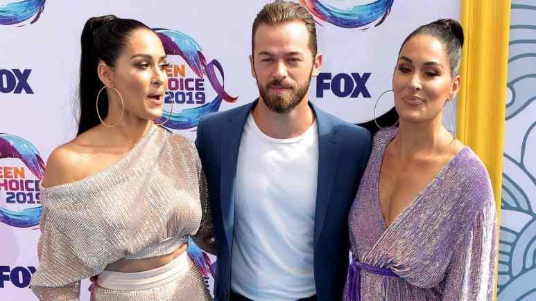 Artem Chigvintsev with Nikki and Brie Bella
