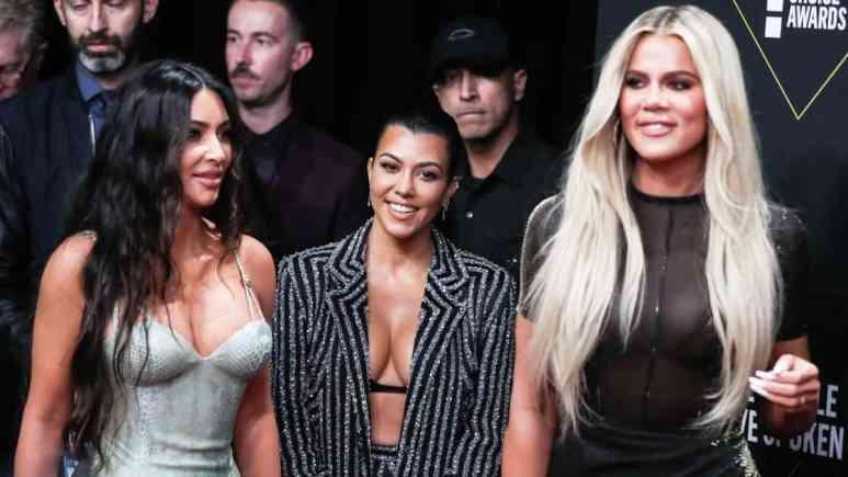 Khloe Kardashian looks busty in denim corset.