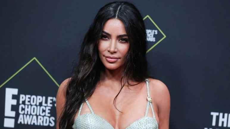 Kim Kardashian models her new bra and shorts brand on Instagram.