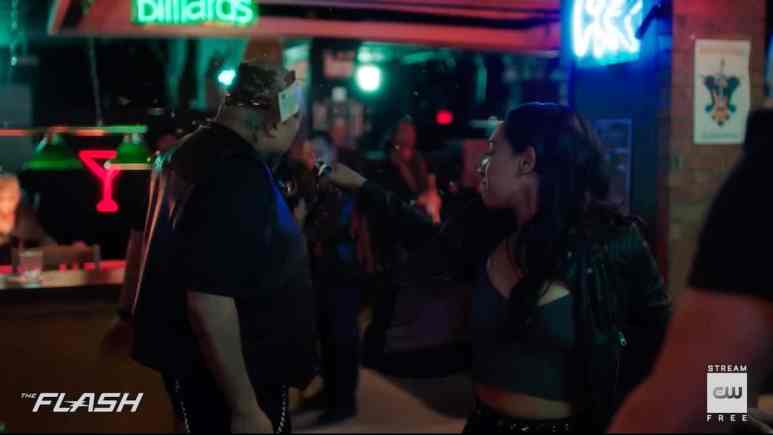 Iris (Candice Patton) holds her own in a bar fight. Pic credit: The CW