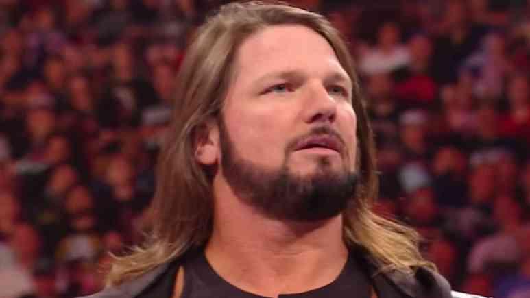 wwe fan taken down in ring after aj styles match on raw