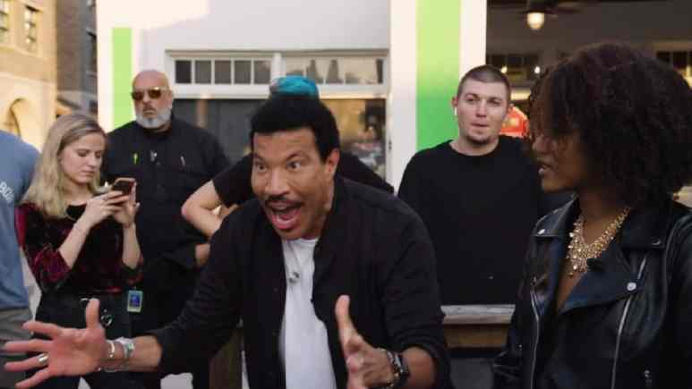Idol judge Lionel Richie hypes up a crowd on the streets