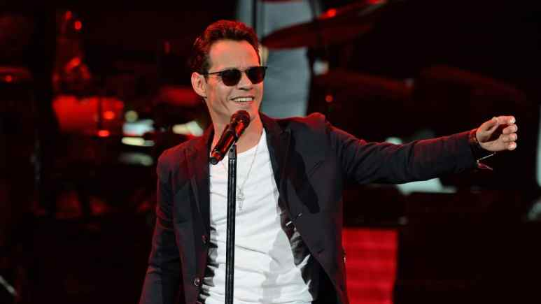 Marc Anthony singing on stage