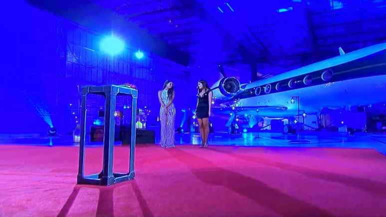 On The Bachelor season 24 episode 8, contestants Madison and Hannah Ann wait in an airplane hangar to hear Peter's decision.