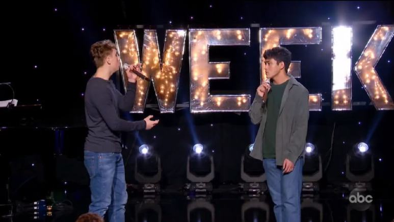 Idol contestants Louis Knight and Francisco Martin sing a duet on stage in Hollywood Week