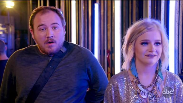 Idol contestant Madison stands next to her duet partner Peyton, who looks confused